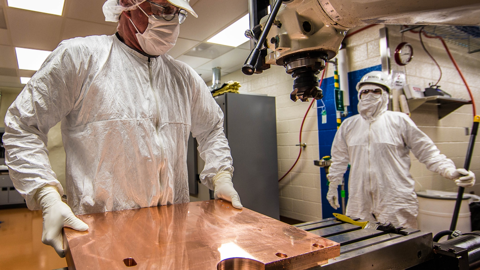 Machinist examines a copper plate