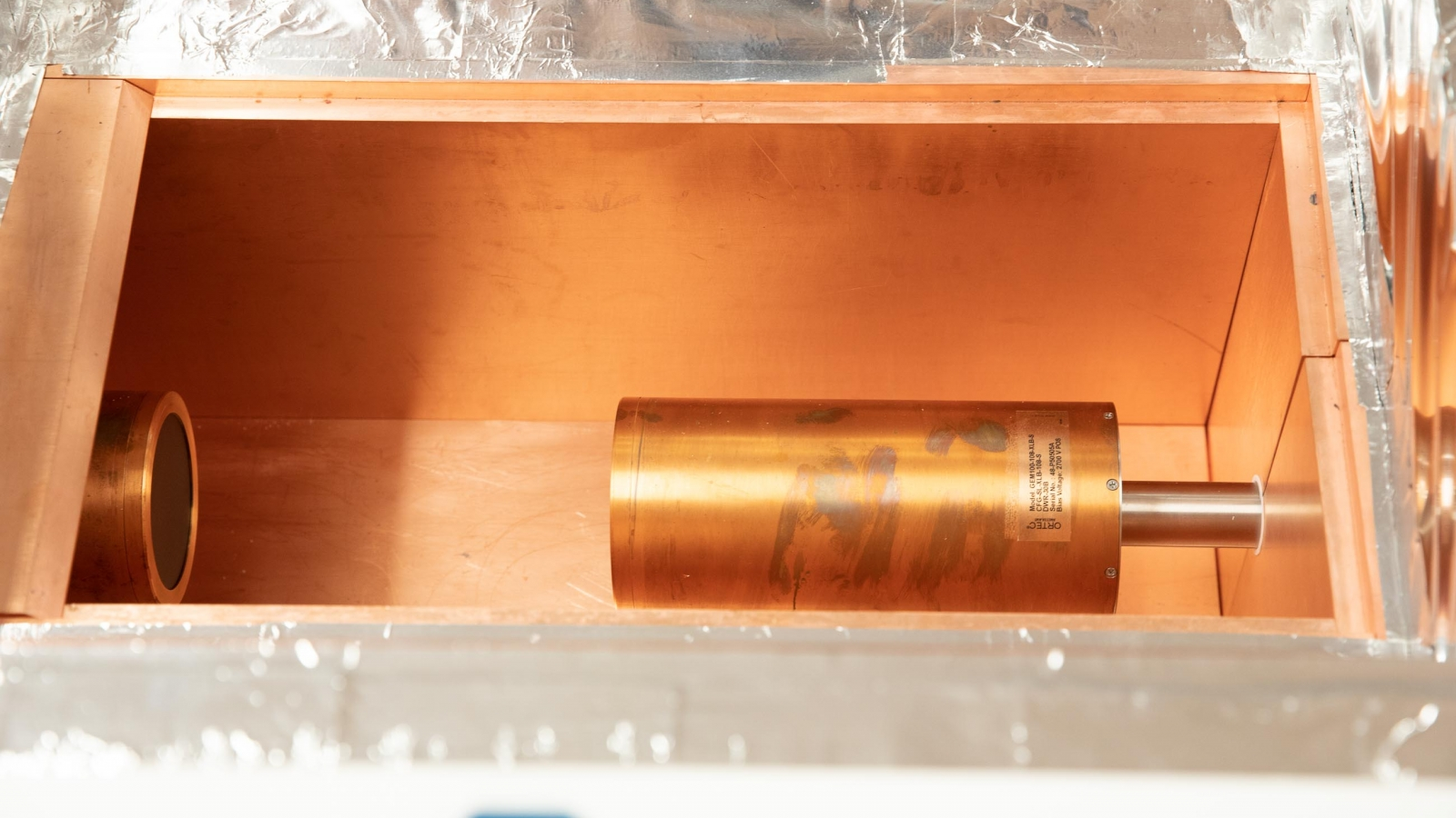 the crystals are wrapped in a copper cryostat.