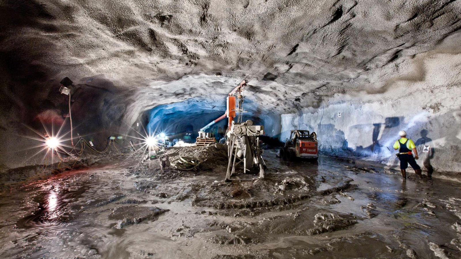 Shotcrete covers the rock walls in a cavern.