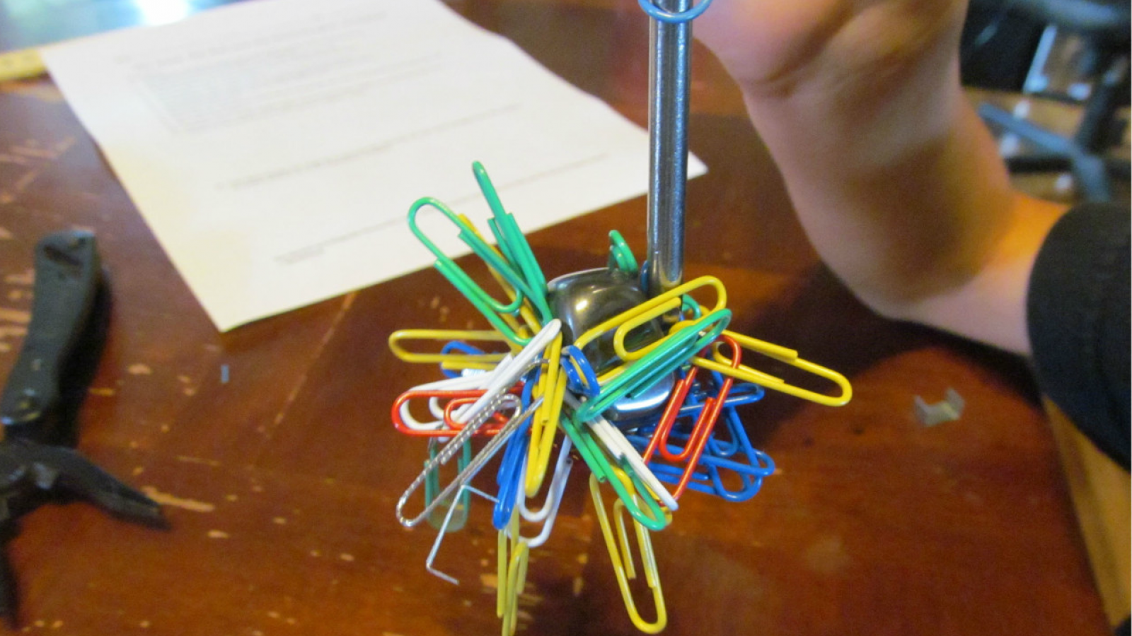 Electromagnet holding paperclips