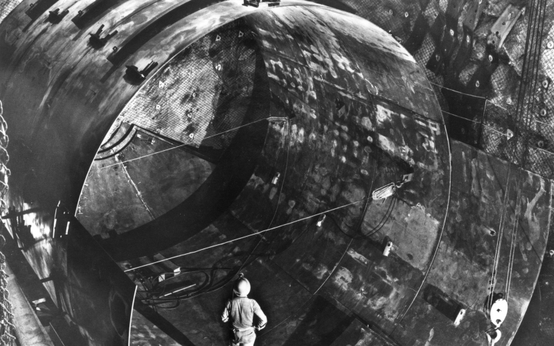 Davis looks at hit neutrino tank during construction.